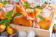 Peach lemonade (Speleolog) Tags: autumn red summer food white cold macro green ice water glass yellow fruit vintage wooden leaf juicy lemon cool healthy mixed raw wine drink sweet juice background beverage harvest peach mint plate fresh lemonade cocktail cube apricot nectar taste organic portion punch nectarine liquid sangria herb peppermint icetea freshness refreshment
