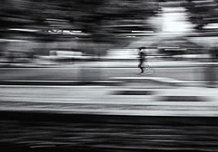 Runner in Lyon (johnsinclair8888) Tags: blur art monochrome france street lyon bw nikon runner rhone fall people motion speed nikkor28300
