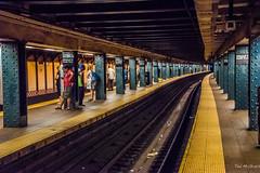2016 - New York City - South FerryWhitehall Street Stn. (Ted's photos - Returns late November) Tags: 2016 cropped nikon nikond750 nikonfx nyc newyorkcity tedmcgrath tedsphotos vignetting southferrywhitehallstreet subway subwaystation subwaystationnyc platform perspective converginglines cellphone backpack tracks traintracks