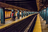 2016 - New York City - South Ferry–Whitehall Street Stn. (Ted's photos - For Me & You) Tags: 2016 cropped nikon nikond750 nikonfx nyc newyorkcity tedmcgrath tedsphotos vignetting southferry–whitehallstreet subway subwaystation subwaystationnyc platform perspective converginglines cellphone backpack tracks traintracks