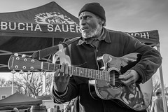 Song for a Rising Sun (ttsayhey1) Tags: street musician guitar singer black white