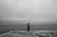 en silence (Georgina ) Tags: blackandwhite monochrome people alone woman sea contemplation thinking moody overcast greece athens