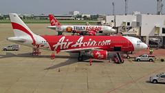 0109b - Don Muang Airport, Bangkok, Thailand (foxxyg2) Tags: red thailand bangkok aircraft aviation thai passenges
