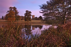 The Church of St Mary the Virgin, Fawsley. (icimages76) Tags: morning pink november autumn red sky lake church water leaves sunrise reeds landscape dawn northamptonshire lakeside holy stmary rushes fawsley sidelight