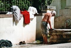 scan_03: Washing clothes (Andra Schiavo) Tags: rome roma homeless clothes washing vestiti lavare senzatetto