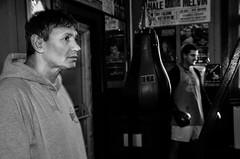Candid portrait of boxing trainer/promoter Chris Sanigar with boxer Krystian Nadolski, in his Bristol gum (sophie_merlo) Tags: portrait blackandwhite bw black blancoynegro sports sport bristol blackwhite bn boxing chrissanigar krystiannadolski