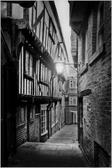 York Alley (SFB579 Namaste) Tags: county york uk england stone architecture dark alley nikon place pavement yorkshire alleyway paving nikkor slabs mediaeval d610 medeivel lightblackandwhite timberframedhouse woodenframedhouse
