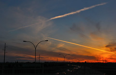 Springtime Highway Sunset (LostMyHeadache: Absolutely Free *) Tags: street light sunset shadow sky motion cars weather clouds canon lights evening spring highway contrail glow dusk silhouettes dramatic atmosphere headlights vehicles davidsmith calgaryalbertacanada eos60d