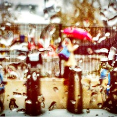 Rainy snow (stoenescualina) Tags: seasons cold drop weather blurry red umbrella girl woman snow rain raindrop