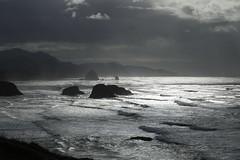 Cannon Beach, Oregon. (Andy Ziegler) Tags: seashore cannonbeach oregon ecolastatepark canon6d backlighting silhouette haystackrock monolith travel tourism pacificnorthwest waves water tide landscape shoreline lanscape mountains beautiful magical