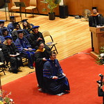 Aldis Sipolins is hooded by Frances Wang, Associate Head for Graduate Affairs