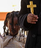 """O my God, in Thee have I trusted, let me not be ashamed; let not mine enemies triumph over me."" (ybiberman) Tags: israel jerusalem ethiopianchurch girl portrait easter candid streetphotography veil chic cross priest eyes braids"