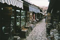 Pewter pews (Karsten Fatur) Tags: film 35mm analogue street alley sarajevo bosnia bosniaandherzegovina metal metalwork shops stores art artists artisans vintage europe travel adventure explore backpacker city history