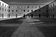 (cherco) Tags: alone lonely silhouette silueta shadow sombra composition vanishingpoint city ciudad sun man light luz lines lineas windows ventanas geometry composicion composicin canon blackandwhite blancoynegro moment momento reflejos reflexions