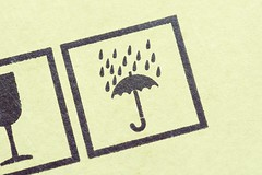 Do Not Get Wet icon stamped on a box (clem bur) Tags: box cardboard caution directions icon paper protection rain raining symbols umbrella warning shipping package copyspace