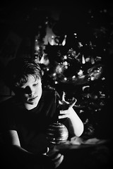 (Natalia Medd) Tags: bw mono monochrome blackandwhite xmas christmas portrait boy christmastree decoration toy playing ornament lights shadows bokeh low key dark contrast kids