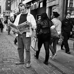 Evening News (Peter.Bartlett) Tags: street city people urban blackandwhite man monochrome pen manchester reading mono newspaper blackwhite unitedkingdom candid streetphotography olympus nik olympuspen blackdiamond ep3 m43 blackwhitephotos streetphotographyurban fragmentsoftime niksilverefex microfourthirds peterbartlett olympuspenep3