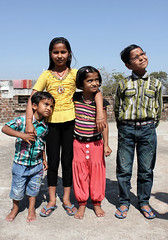 Village Kids (cowyeow) Tags: travel family roof portrait people india cute rooftop boys smile kids children happy child brothers sister candid indian smiles together friendly local pradesh khajuraho madhyapradesh madhya