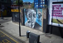 Hackney Boss (Sven's extras (sven loach)) Tags: road street uk summer england urban streetart london graffiti glasses cool nikon warm britain pavement tag sunny cigar gritty hackney colourful hip rollingstones eastlondon hackneyroad d5100 nandomambo