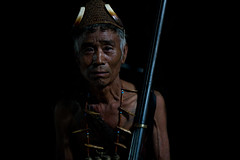 Konyak head-hunter. Mon district, Nagaland. NE India (NeSlaB .) Tags: world poverty old travel portrait india man face look tattoo last canon dark photo necklace eyes lowlight asia gun indian traditional rifle culture photojournalism tribal bones warrior mon tribe ethnic society developingcountries reportage nationalgeographic naga nagaland ethnography ethnology headhunter headhunters neindia ethnies konyak neslab