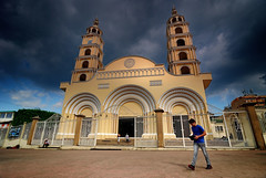 heavenly by day, sinister by night.. (Coand) Tags: colour tower history church yellow architecture clouds contrast dark mexico holidays day locals god columns wideangle clocktower tokina filter manual f56 veracruz vignetting minatitlan historicbuildings d80 1xp controlpoint 1116mmf28 gradualneutralgreyg2