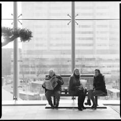 Utrecht Centraal (Pim Geerts) Tags: old girls news man station train bench paper hall newspaper women utrecht metro kodak bank bronica hal oude meisjes commuters architectuur sqa centraal vrouwen mensen krant nieuwbouw forensen tx400 reizigers cu2013