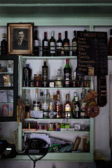 Greek traditional coffee shop (Vasilis Mantas) Tags: old sea summer portrait man coffee shop canon island greek cafe wine telephone traditional whiskey greece drinks alcohol cigarettes ouzo 1740 paxos campari paxoi ionian 500d  2013 magazia      vmantas vmantasphotography mpournaos bournaos