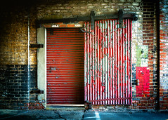 Behind the Red Door (Sky Noir) Tags: door red urban industrial decay warehouse behind artifact urbex skynoir