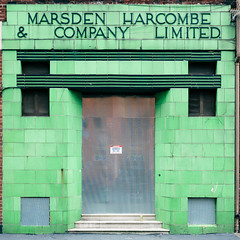 Marsden Harcombe (Peter.Bartlett) Tags: manchester square unitedkingdom abstract city doorway drainpipe colour lunaphoto shutter urban text uk kodakportra160emulation wall vsco sign urbanarte facade door tiles commercial frontage steps window boardedup ancoats artdeco