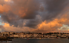 Clouds over St Peter Port (Ian Toms) Tags: daybreak guernseyharbours sunrise grey golden harbour water sea sky dawn boats yellow stpeterport clouds