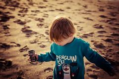 Takes it everywhere (lermaniac) Tags:  kids sunset beach sea dusk  surf waves outdoors boy