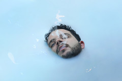 Milk eye (Giulio Musardo) Tags: face water white dark smog smoking eyes light portrait realistic dreams surrealism sea blue emotion conceptual fine art photography fineart giulio musardo
