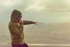 Man at the summit speaking on the phone (esevelez) Tags: espaa sealando montaa alto arm brazo calido cantabria capucha chico gafas high hombre hoodie landscape liencres man mobile mountain movil phone picota pointingat rio river sealar spain speaking sunglasses talking telefono warm