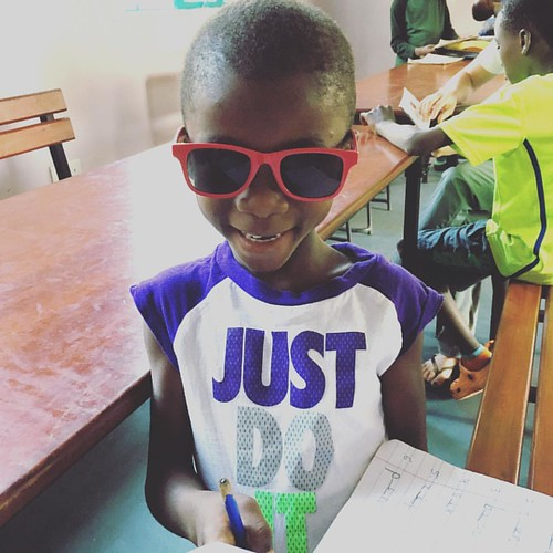 "Who said you couldn't be styling while doing homework?! Subira is rocking her new sunglasses she earned with our positive reinforcement program! 📝😎#educationisthekey #sponsorachild #neemaintl • <a style=""font-size:0.8em;"" href=""http://www.flickr.com/photos/59879797@N06/30787028491/"" target=""_blank"">View on Flickr</a>"