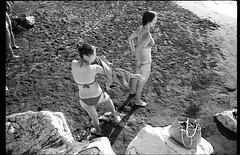 (Spanish Pin Ups) (Robbie McIntosh) Tags: leicamp leica mp rangefinder streetphotography 35mm film pellicola analog analogue negative leicam analogico blackandwhite bw biancoenero bn monochrome argentique autaut dyi selfdeveloped filmisnotdead kentmere100 kentmere 100 stranger elmarit leicaelmarit28mmf28iii elmarit28mmf28iii 28mm arsimagofd beach summertime onthebeach colonnaspezzata speedo swimsuit bathers girls women strangers