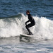 A surfer rides a wave off Manasquan Beach.