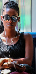 My longing to a proof by contradiction, and life underground (ybiberman) Tags: israel jerusalem lighttrail girl adolescent ethiopian sunglasses cellphone smartphone headphones portrait candid streetphotography necklace