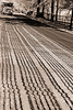Lines in the road (jcdriftwood) Tags: road street blackandwhite pave tar resurface blacktop parallel dumptruck truck inline