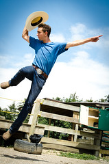 Yee-Haw  :) (Truebritgal) Tags: ranch wood blue ohio sky brown white man guy green hat shirt lens belt jump jumping nikon cowboy finger air tire jeans western nikkor pointing stable leap youngman leaping jewett faithranch 18200mm concho d7000 truebritgal