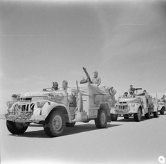 Chevrolet 30cwt trucks of an LRDG patrol moving out into the desert, 25 May 1942.