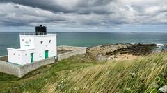 Bamburgh Lighthouse (Johnners61) Tags: uk england lighthouse lumix coast moody panasonic northumberland northumbria northsea coastline bamburgh moodysky lx5 bamburghlighthouse