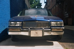 Cadillac (inafreeland) Tags: city blue urban film philadelphia car analog 35mm blurry classiccar pennsylvania oldschool cadillac outoffocus pa philly manual grainy southphiladelphia imperfect kodakektar100 afgaoptima