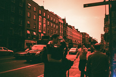redscale kiss. (theperplexingparadox) Tags: ireland dublin love film analog 35mm hug kiss kissing couple candid streetphotography 135 olympusxa redscale couplekissing irishlove redscalefilm