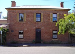 Heritage listed Georgian style box shaped house in main street of Nairne. 12 paned windows, shutters, perfect proportions and symmetry. Built for Henry Timmins a tanner. 3 paned fan light above doorway. Probably built in 1851 when Timmins opened his tanne (denisbin) Tags: timmins shutters georgian heritagelisted nairne adelaidehills symmetry fanlight
