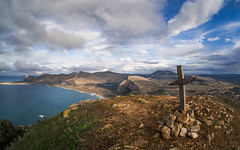 The summit (jeff_006) Tags: sea italy panorama cloud mountain seascape travelling landscape bay san mediterranean cross hiking olympus lo fisheye summit sicily mm 75 capo vito holyday f35 samyang em5