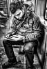 Sherlock Holmes - Studying - Orange Line (Dark-Wing Duck) Tags: street people bw woman white man black bus men public underground subway real island person women ride metro mtl montreal candid secret monotone grayscale hdr sits 514 greyscale fictional iphone wierdo unauthorised greytones graytones