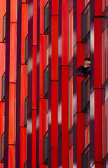 - the red apple - (Jacqueline ter Haar) Tags: theredapple rotterdam red rood architecture woontoren rode verspringende aluminium gevel windows balconies human moment
