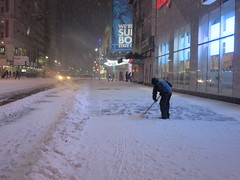 Shoveling snow from the sidewalk at the One Times Square Building where the New Years Eve Ball is dropped in New York City, USA during winter snow storm (RYANISLAND) Tags: nyc newyorkcity usa snow ny newyork storm cold weather america 14 snowstorm freezing american timessquare snowing storms wintersnow coldweather northeast extremeweather winterstorm noreaster winterweather 2014 snowstorms weatherstorm winterstormhercules