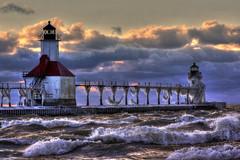 Icy rage (Notkalvin) Tags: lighthouse storm ice beach waves stjoseph lakemichigan greatlakes explore flickrexplore explored mikekline michaelkline puremichigan notkalvin notkalvinphotography