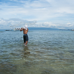 Fisher (andy _kip) Tags: sea man net water clouds boat philippines catching fisher